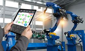 Tablet und Industrieroboter