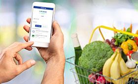Smartphone und Obstkorb